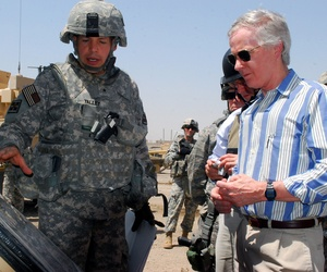 Brig. Gen. Jeffrey Talley (left), 926th Engineer Brigade commander, explains to Ambassador Ryan Crocker (right), U.S. ambassador to Iraq, what his troops have been accomplishing in the Sadr City District of Baghdad, July 23.