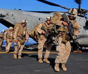 Marines with the 11th MEU offload from a CH-53E Super Stallion on December 12, 2014.