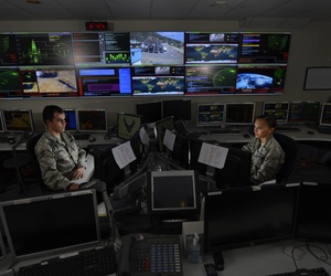Two troops with the Global Strategic Warning and Space Surveillance System Center monitor systems at Cheyenne Mountain Air Force Station, Colo., on September 2, 2014.