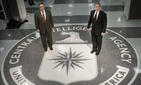 In a March 2001 file photo, then President George W. Bush and then-CIA director George Tenet pose at the CIA seal in the main entrance of agency headquarters in Langley, Va.