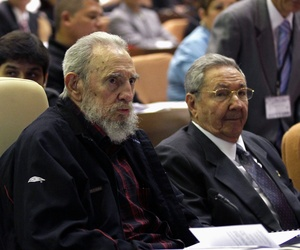 Cuba's President Raul Castro, and brother Fidel Castro, attend the opening session of the National Assembly in Havana, on February 24, 2012.