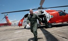 U.S. Coast Guard Adm. Thad Allen walks away from his helicopter in Mobile, Ala., following an air tour of Dauphin Island and the Alabama coast on Saturday, June 5, 2010.
