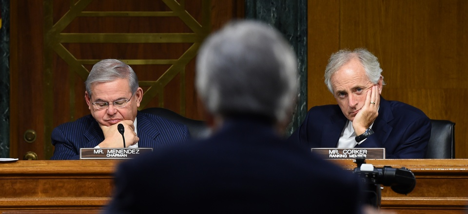 Sens. Robert Menendez and Bob Corker watch as Secretary of State John Kerry testifies on Capitol Hill, on December 9, 2014.