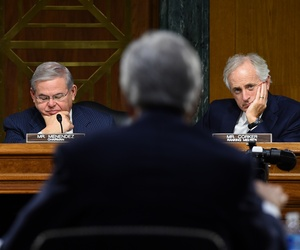 Sens. Robert Menendez and Bob Corker watch as Secretary of State John Kerry testifies on Capitol Hill, on December 9, 2014.