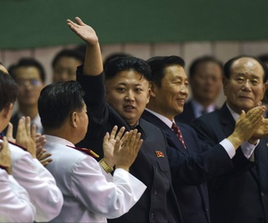 North Korean leader Kim Jong Un waves as he arrives for the Arirang mass games at May Day Stadium in Pyongyang, North Korea, on July 26, 2013.