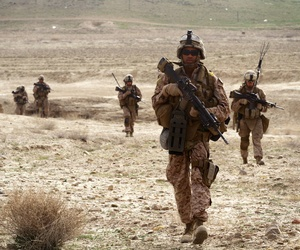 A group of enlisted Marines patrol near Observation Post Shrine in the Kajaki District, Afghanistan, on March 16, 2012