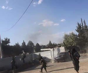 ISIS fighters engage in battle in Kobani, Syria.