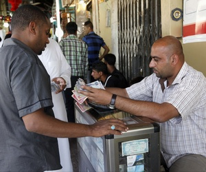 A man exchanges money at a street money changer in Karbala, Iraq, on June 23, 2013.