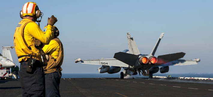 An EA-18G Growler launches from the flight deck of the aircraft carrier USS Carl Vinson as the ship conducts flight operations in the U.S. 5th Fleet area of responsibility, Jan. 1, 2015.