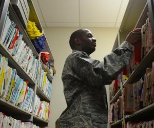A U.S. Airman files patient records at the USAF Hospital Langley flight medicine clinic at Langley Air Force Base, Va., Dec. 16, 2013.