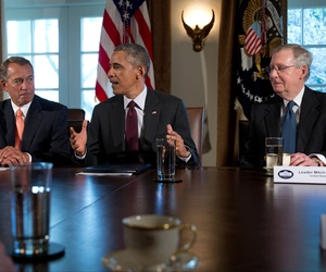 President Obama, flanked by House Speaker John Boehner and Senate Majority Leader Mitch McConnell, speaks to media as he meets with the bipartisan, bicameral leadership of Congress, on January 13, 2015.