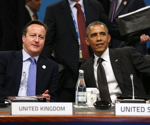 President Barack Obama and British Prime Minister David Cameron talk at the start of the plenary session at the G20 Summit in Brisbane, Australia, on November 15, 2014.