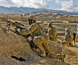 A soldier with the 10th Mountain Division provides security for ANSF troops in Kharwar District, on January 15, 2014.