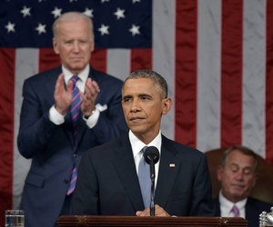 President Obama, with Vice President Joe Biden and House Speaker John Boehner in the background, delivers his 2015 State of the Union address to Congress, on January 20, 2015.