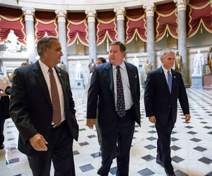 Rep. Ken Calvert, R-Calif., talks to Rep. Jeff Miller, R-Fla..,as they walk to the House chamber, on October 3, 2013.