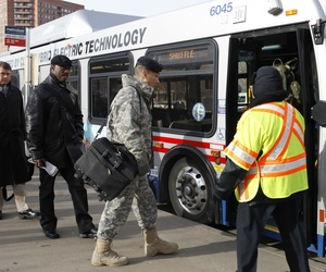 People board a shuttle bus headed for the Pentagon at the Pentagon City Metro stop in Arlington, VA.