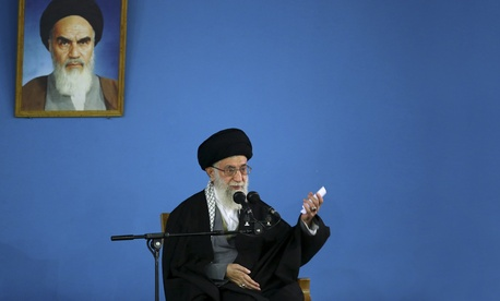Supreme Leader Ayatollah Ali Khamenei waves to a crowd prior to a speech at his residence in Tehran, Iran, on January 7, 2015.
