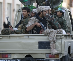Houthi Shiite fighters wearing an army uniform ride on a pickup vehicle as they patrol a street during a demonstration to show support for their comrades in Sanaa, Yemen, Friday, Jan. 23, 2015.