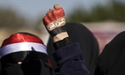 "A woman raises her fist painted with Yemen's flag and Arabic writing that reads, ""Yemen is safe,"" to protest against the Houthi Shiite rebels who hold the capital, Sanna, during a demonstration in Sanaa on Saturday, Jan. 24, 2015."