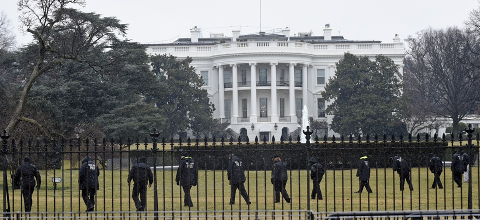 Secret Service Agents search the grounds near the White House after an unmanned aerial vehicle was found crash landed on the complex.