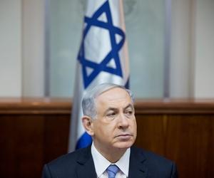 Israeli Prime Minister Benjamin Netanyahu attends a weekly cabinet meeting in Jerusalem, Sunday, Jan. 4, 2015.