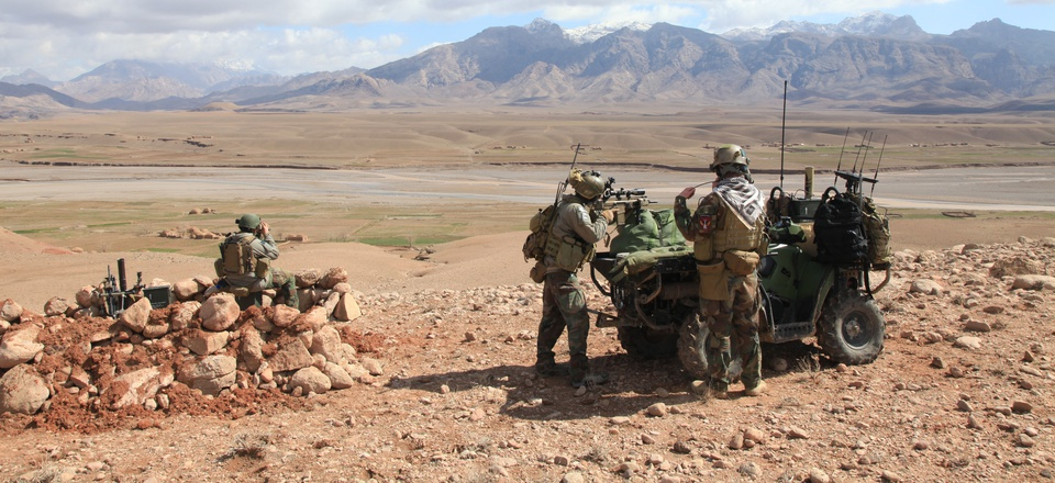 Marines with U.S. Marine Corps Forces, Special Operations Command provide security during a two-day presence patrol with Afghan Commandos in Farah province Feb. 27. 2012