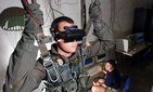 A Marine using a virtual reality parachute trainer.