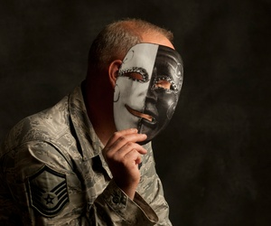 An Airman who struggles with Post-Traumatic Stress Disorder and says putting on a happy face to get through a day is like wearing a mask.