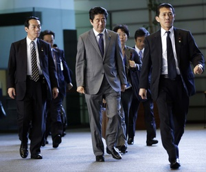 Japan's PM Shinzo Abe walks through the prime minister's official residence in Tokyo, on Friday, Jan. 30, 2015.