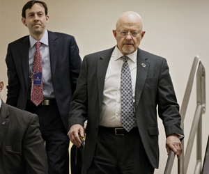 Director of National Intelligence James Clapper walks out of a briefing at the Senate, on February 27, 2014.