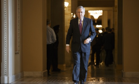 Senate Majority Leader MItch McConnell, R-Ky., walks to the Senate chamber on Capitol Hill on January 29, 2015.