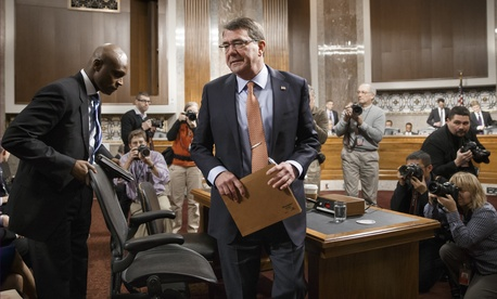 Defense Secretary nominee Ashton Carter takes a break during his nomination hearing in front of the Senate Armed Services Committee, on February 4, 2015.