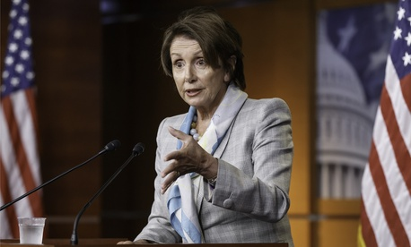 House Democratic leader Nancy Pelosi, D-Calif., takes questions from reporters during a news conference at the Capitol.