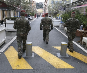 Soldiers patrol in a street in Nice, southeastern France, Wednesday, Feb. 4, 2015.