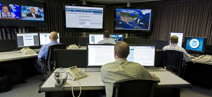 """Cyber security analysts work in the """"watch and warning center"""" at the DHS's secretive cyber defense lab in Idaho Falls, Idaho."""