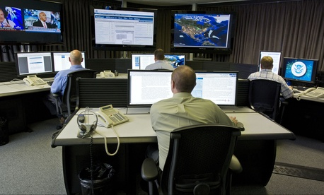 "Cyber security analysts work in the ""watch and warning center"" at the DHS's secretive cyber defense lab in Idaho Falls, Idaho."