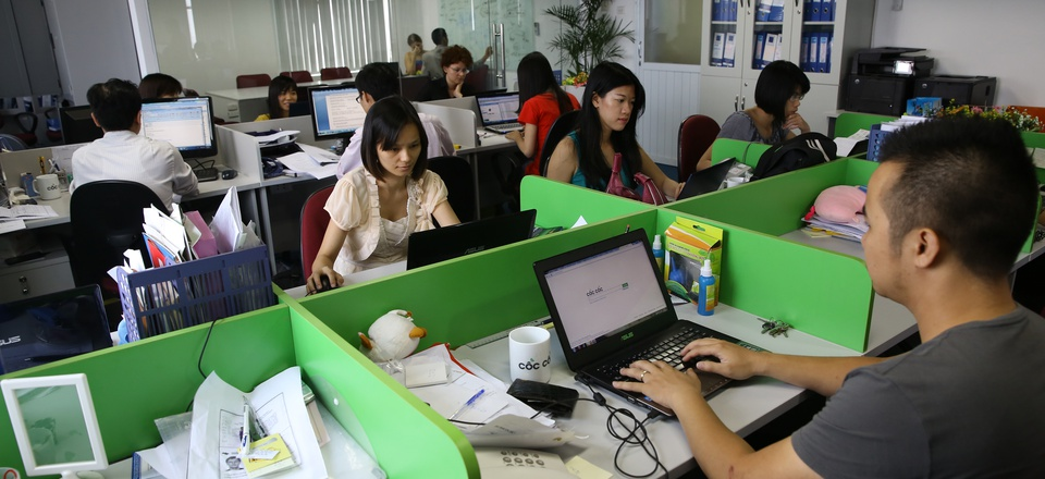 Staff work at a newly launched Russian- Vietnamese web company which is developing its search engine technology.