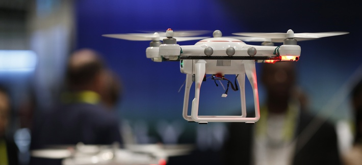 Drones fly at the Autel booth during the International CES Wednesday, Jan. 7, 2015, in Las Vegas