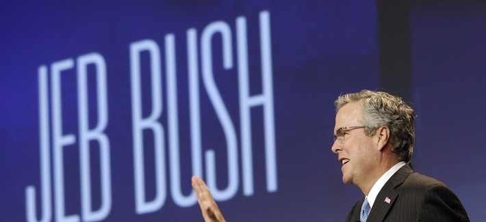 Former Florida Gov. Jeb Bush waves while being introduced on Friday, Jan. 23, 2015.