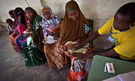 Somali mothers wait in line to have their babies examined before receiving a five-in-one vaccine against several potentially fatal childhood diseases in Mogadishu, Somalia, April 24, 2013.