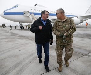 Defense Sec. Ash Carter arrives in Kabul, Afghanistan, on his first trip abroad as defense secretary, walking with Gen. John Campbell.