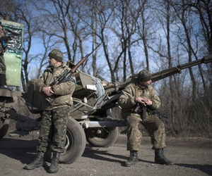 Ukrainian military soldiers rest their vehicle near Artemivsk, eastern Ukraine, on Feb. 23, 2015.