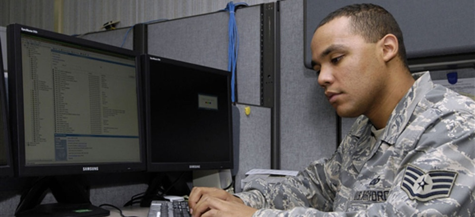 An Air Force NCO works on a computer station at Scott Air Force Base, Ill.