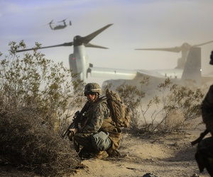 Cpl. Paul Regotti, a squad leader with 3rd Battalion, 7th Marine Regiment, provides security for Marines exiting an MV-22 Osprey during an air assault on a Military Operation on Urbanized Terrain town.