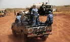 Sudanese armed forces ride a military vehicle at the border town of Heglig, Sudan, on April 24, 2012.