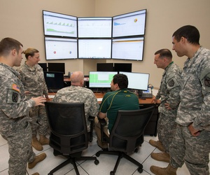 Soldiers with the Georgia Army National Guard train at the GTRI on cyber defense capabilities.