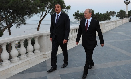 Russian President Vladimir Putin, right, walks with Azerbaijan's President Ilham Aliyev, on Aug. 13, 2013.
