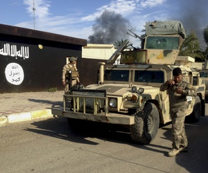 Iraqi army soldiers deploy in front of a court run by the Islamic State group after a military operation to regain control of the town of Sadiyah in Diyala province, 60 miles north of Baghdad, Iraq.