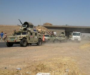 Iraqi security forces head to Baghdad on the main road between Baghdad and Mosul, on June 11, 2014.