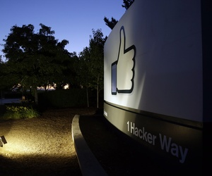 """The Facebook """"like"""" symbol is illuminated on a sign outside the company's headquarters in Menlo Park, Calif., Friday, June 7, 2013."""